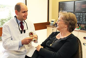 Dr. Rapoport showing model to patient